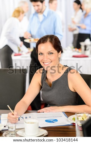 Business woman at company meeting work during buffet lunch