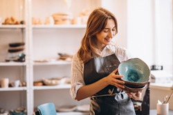 Business woman at her pottery store