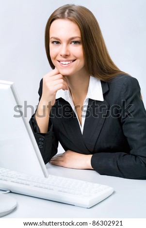 Business woman at the office with a computer