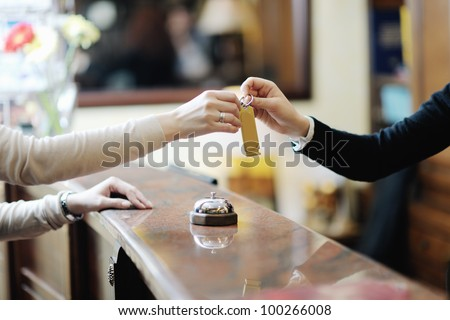 business woman  at the reception of a hotel checking in #100266008