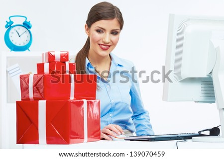 Business woman at work in office. Red gift box on table. Female business model.