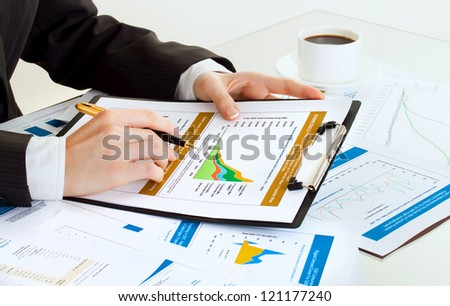 business woman at workplace counting