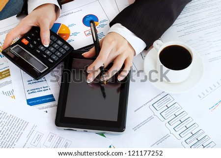 business woman at workplace with tablet pc
