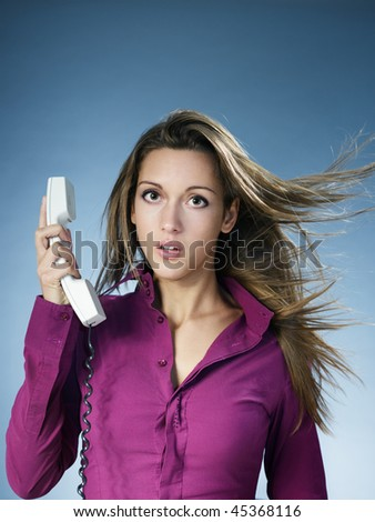 business woman being yelled over the phone. Copy space