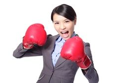 Business woman boxing ready to fight. Strength, power or competition concept image of beautiful strong Asian businesswoman isolated on white background.