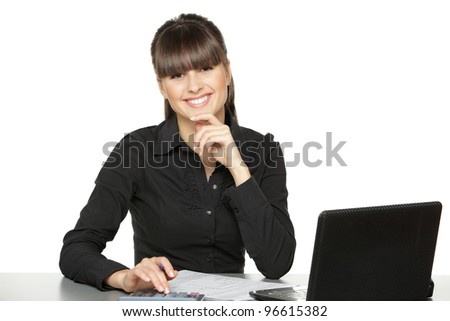 Business woman calculating at office desk, isolated on white background - stock photo
