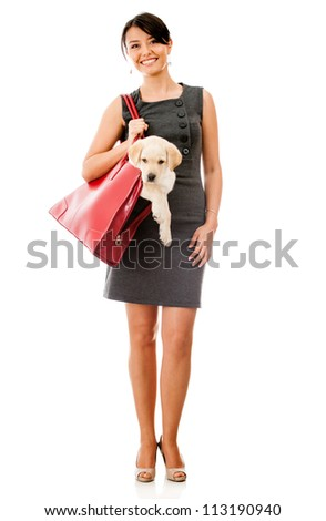 Business woman carrying a dog in her purse - isolated over white