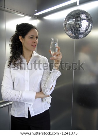 Business woman celebrate with glass of champagne