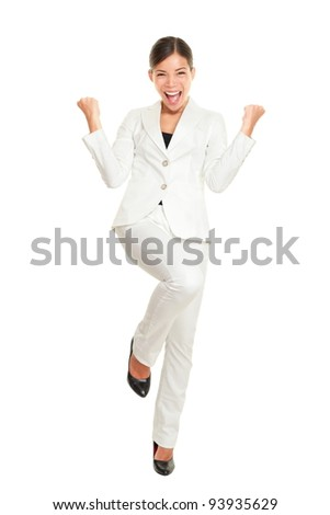 Business woman celebrating happy cheerful in white suit in full body. Cheering winner in joyful dance over success. Young multiracial Chinese Asian Caucasian businesswoman isolated on white background
