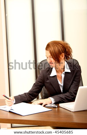 Business woman checking her agenda