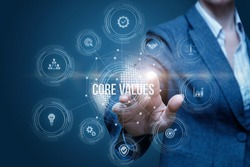 Business woman clicks on the structure of the core values .