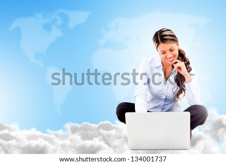 Business woman cloud computing looking very happy using wireless technology