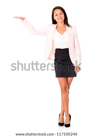 Business woman displaying something with her hand - isolated over white