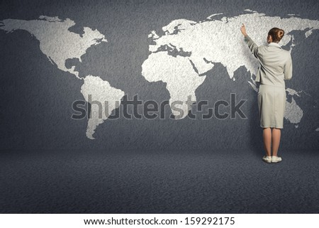 business woman draw a map on the wall, a global business