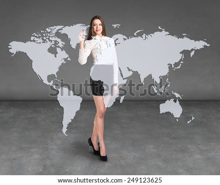 Business woman draw a point on a virtual map, a global business