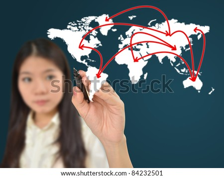 Business woman drawing network on world map