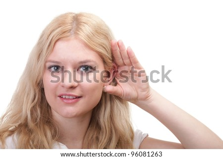 Business woman eavesdropping with hand behind her ear