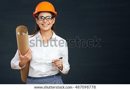 Business woman engineer developer holding blueprint on black background.