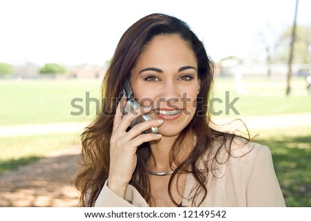Business woman enjoying the outdoors while talking on a cell phone