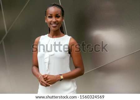 Business woman executive portrait standing, successful smiling staff at financial bank, corporate office