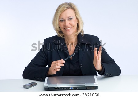 business woman explaining something with the laptop in front of her