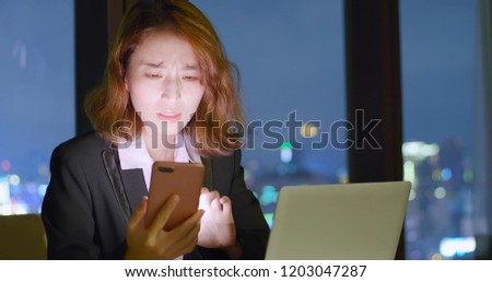 business woman feel tired use phone and notebook work at night #1203047287