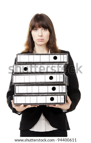 Business woman full of work holding a pile of folders, isolated on white background