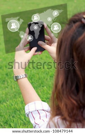 business woman hand holding a phone show the social network