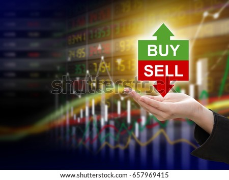 Business woman hand holding buy or sell on stock market background