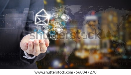 Business woman hand holding E-mail marketing icon at night city view