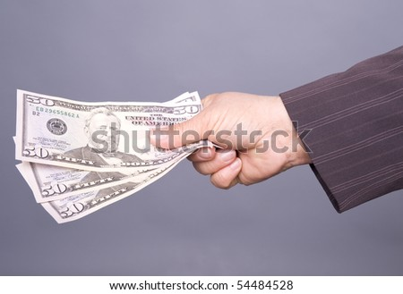Business woman hand offering three hundred dollar bills as an isolated image