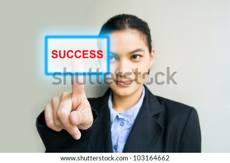 business woman hand pushing success button