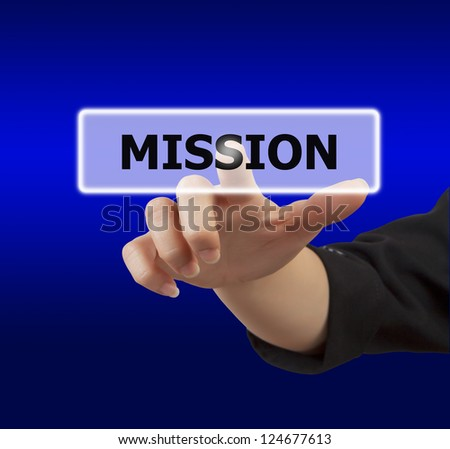 business woman hand touching on mission button