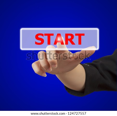 business woman hand touching on start button