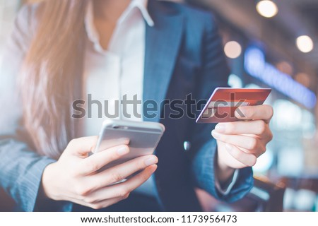 Business woman hand use credit cards and smartphones. #1173956473