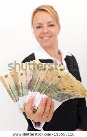 Business woman handing you stacks of romanian currency - shallow depth, focus on money