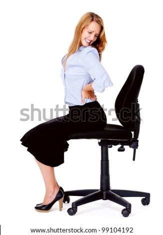 Business Woman Has Back Pain From Sitting In Office Chair Stock