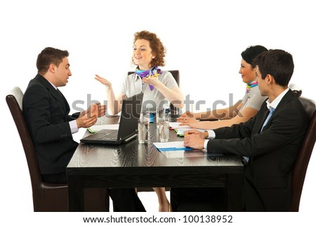 Business woman having conversation with business man at meeting