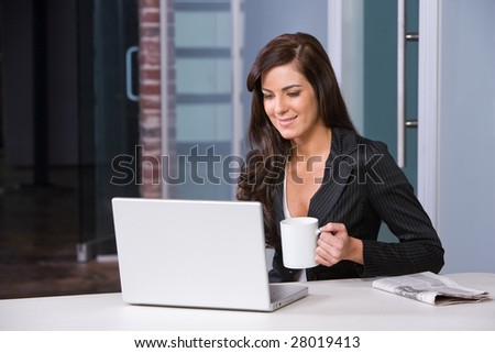 BUsiness woman having her morning coffee