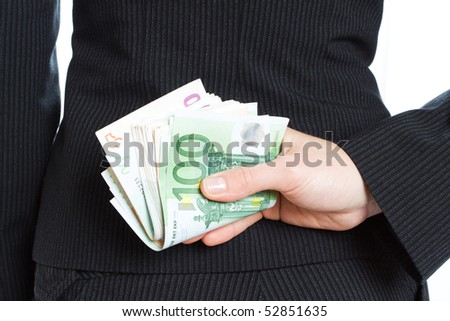 business woman hides money behind