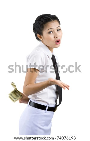 business woman hiding money behind her back, isolated on white background - stock photo