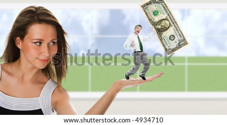 business woman hold man with dollar on palm over window