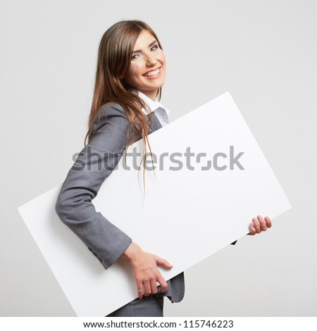 Business woman hold white blank paper. Young smiling girl  show blank board. Female model portrait isolated on white background.