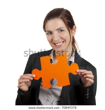 Business woman holding a big puzzle piece, isolated on white