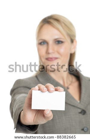 Business woman holding a blank business card isolated on a white background