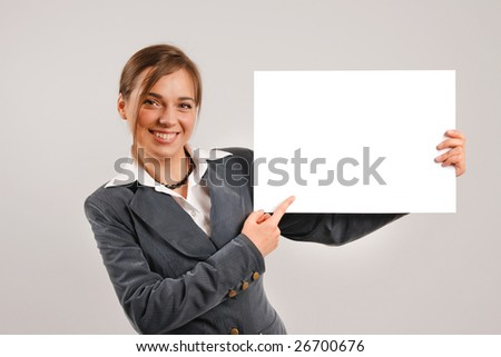 Business woman holding a large blank card