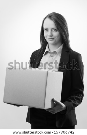 Business woman holding a single cardboard box