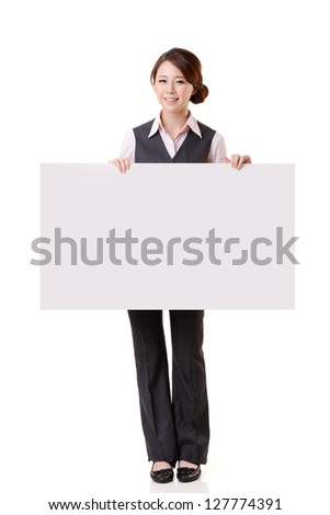 Business woman holding blank board, full length portrait isolated on white background.