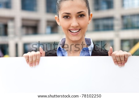 business woman holding blank paper for advertisement