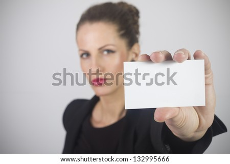Business woman holding business card - stock photo